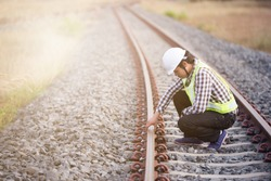 Railroad workers checking railways