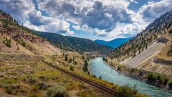 Railway and the Trans Canada Highway follow the Thompson River with its many rapids flowing through the Canyon in the Coastal Mountain Ranges of British Columbia, Canada
