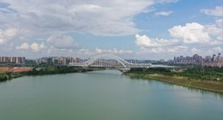 Railway arch bridge across the river in Nanning, China