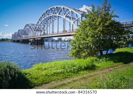 Railway bridge over the Daugava river in Riga, Latvia, on a sunny day