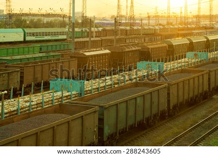 Railway cargo cars carrying coal and logs