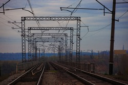 Railway double-track bridge in cloudy weather