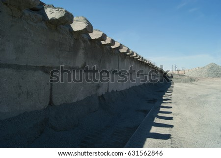 Railway foundation and its shadow on a blue sky background. #631562846