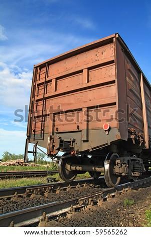 railway freiht-car on rural station - stock photo