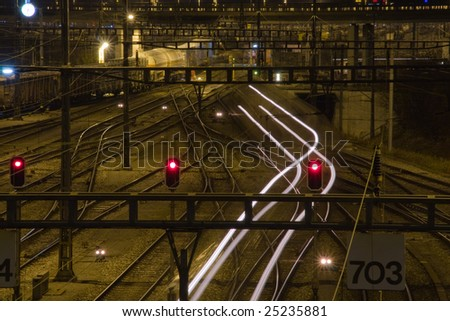 railway humb yard with light signals in the night