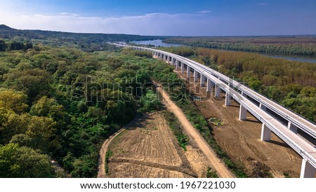 Railway in Cortanovci on Fruska Gora national Park. Danube in background Сток-фото ©