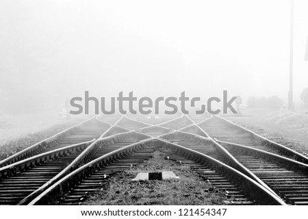 Railway in fog on station, outdoor landscape #121454347