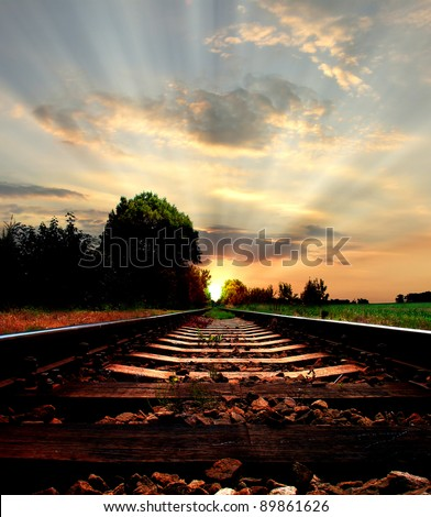Railway in sunset, light at the end of the road