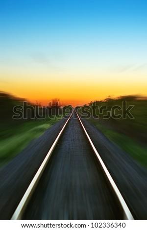 stock-photo-railway-motion-blur-at-sunset-102336340.jpg