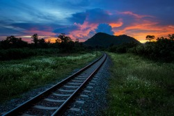 Railway or Railroad against beautiful evening sky at sunset, Industrial landscape in countryside.