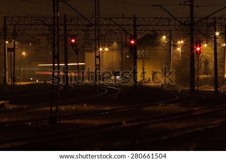 railway platform illuminated at night, building rail, railroad tracks, spotlight
