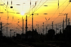 Railway posts with sunset