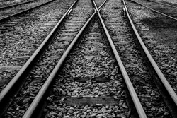 Railway rails that run through grooved sleepers buried under cobblestones
