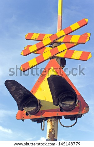 Railway sign and traffic lights at a railroad crossing