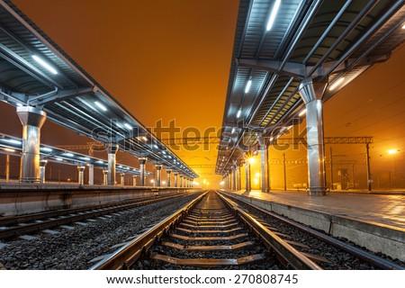 Railway station at night. Train platform in fog. Railroad in Donetsk.  #270808745
