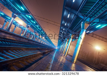Railway station at night. Train platform in fog. Railroad in Donetsk #321329678