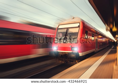 Railway station with modern high-speed  passenger train in motion blur effect Nuremberg, Germany. Railroad