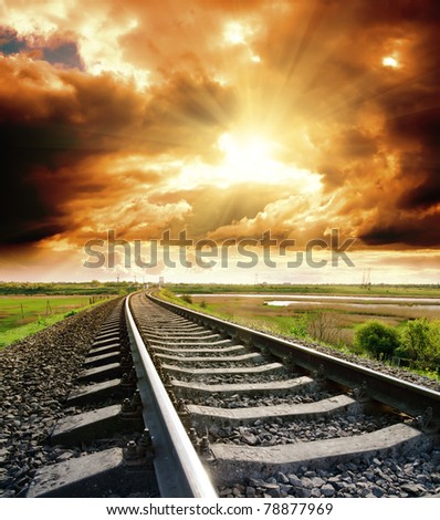 railway to cloudy sky at sunset