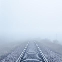 railway to horizon in fog