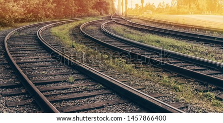 Railway to sunset. Intersection of old rails.