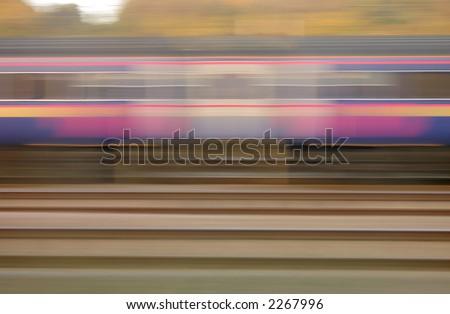 Railway track and train blurred background.