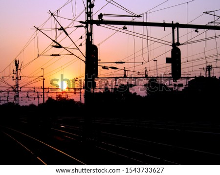 Railway tracks and cables at sunset #1543733627