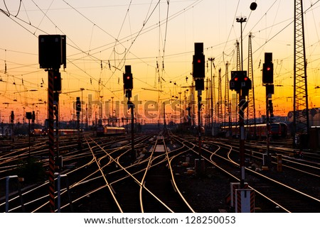 Railway Tracks at a Major Train Station at Sunset.