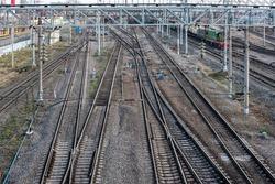 Railway tracks at a train station. Railroad overhead lines.