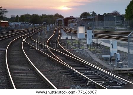 Railway Tracks at Dusk in Urban Setting