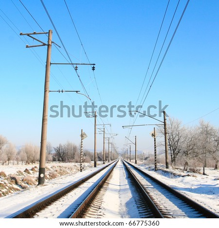 Railway tracks covered with snow