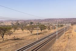 Railway Tracks Dry Landscape Railway train tracks line travel through dry season rural landscape