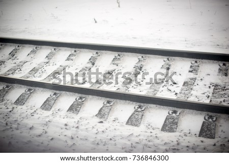 Railway tracks for trains covered with snow