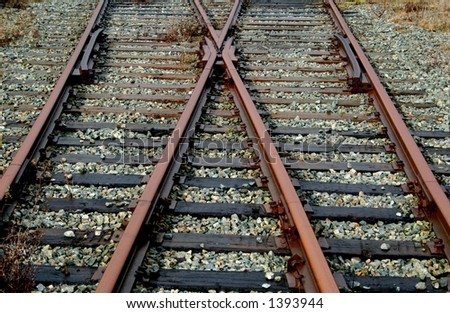 Railway tracks lead off in two different directions.