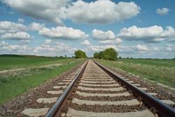 railway tracks on background of scenery