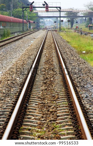 Railway Tracks, single track and signalling at train staion.