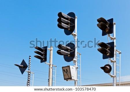Railway Traffic Lights against blue sky background
