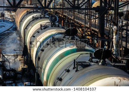 Railway trains with tanks for the transport of petroleum products are on the siding