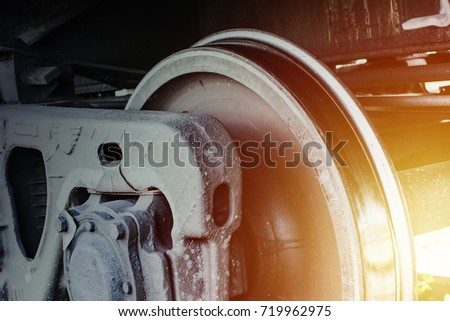 Railway transportation background. Train wheel close up. Heavy metallic construction