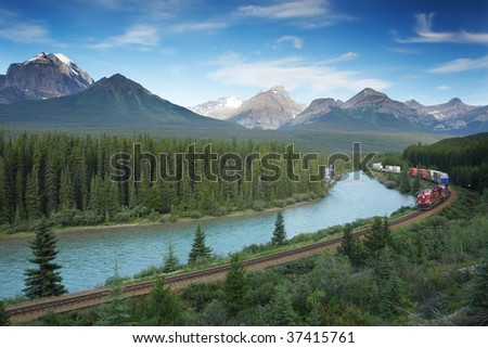 Railway with train in Banff National Park, Canadian Rockies