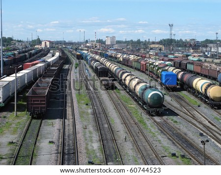 Railway yard with a lot of railway lines and freight trains