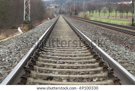 Railways on a stone platform, rails, road