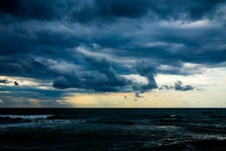 rain and large dark clouds over the sea