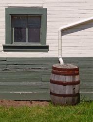 Rain barrel beside nineteenth century building