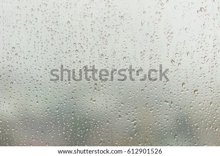 Rain caught at the window glass in rainny day. #612901526
