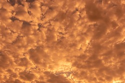 Rain clouds. Dramatic sky. Tints and colors of the sunset. Feeling of freedom. South America summer. Background. Background image of scene. Freedom sky. Clouds loaded.