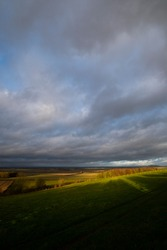 Rain clouds over farmland fields in the rural county of Hampshire