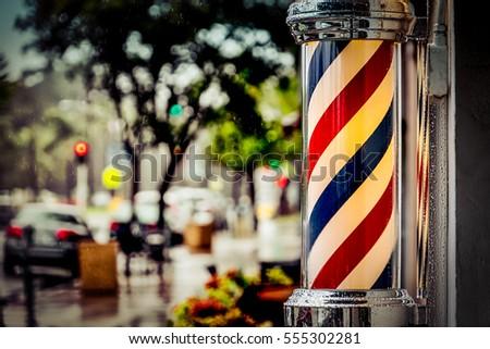 Rain collecting on the barber shop pole in Coronado, California.