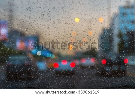 Rain drop On the car Glass Background. photo blurred of car on the Street #339061319