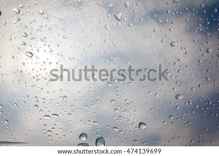 rain drop on the plastic roof with the sun light #474139699