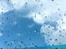 Rain drop on the window with sky view.